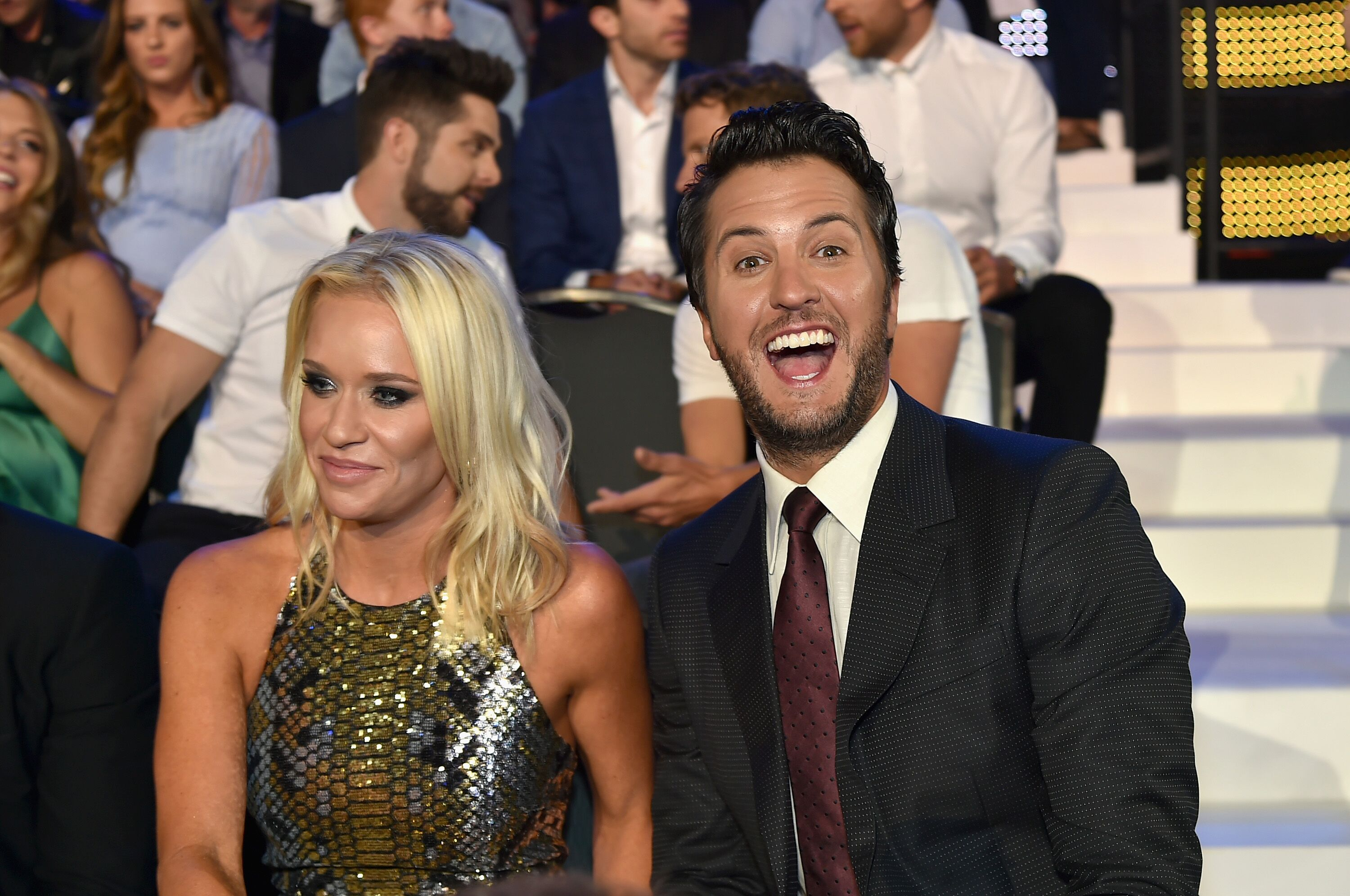 Luke Bryan (R) and Caroline Boyer (L) watch the 2017 CMT Music awards at the Music City Center | Getty Images / Global Images Ukraine