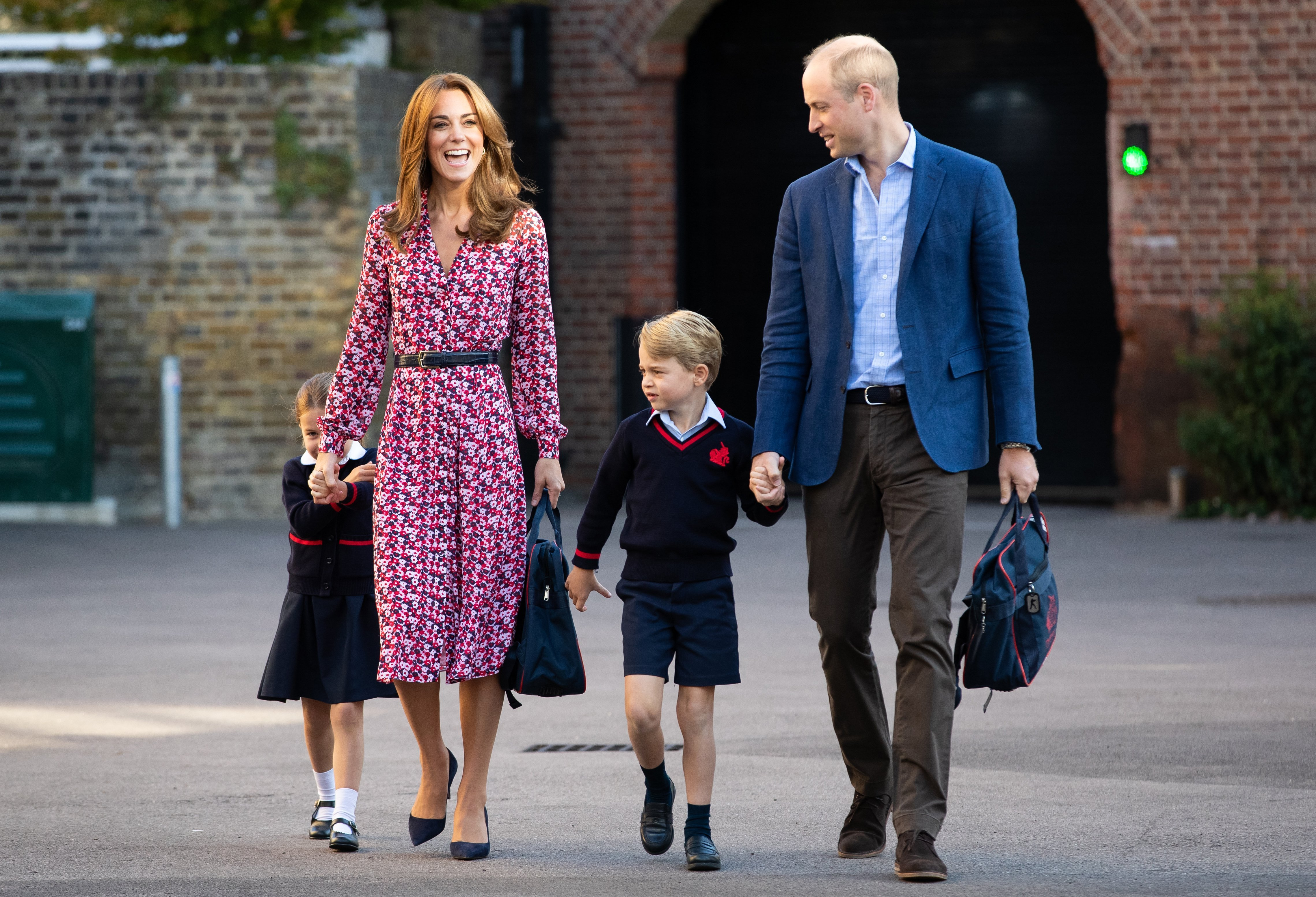 Duchess Kate and Prince William arriving with Princess Charlotte and Prince George at Thomas's Battersea on September 5, 2019, in London, England | Photo: Getty Images