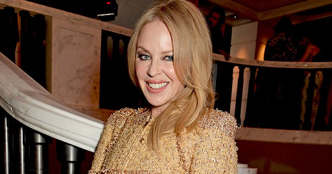 Kylie Minogue, 52, Defies Age Flaunting Her Killer Curves in a Skintight Sheer Yellow Outfit