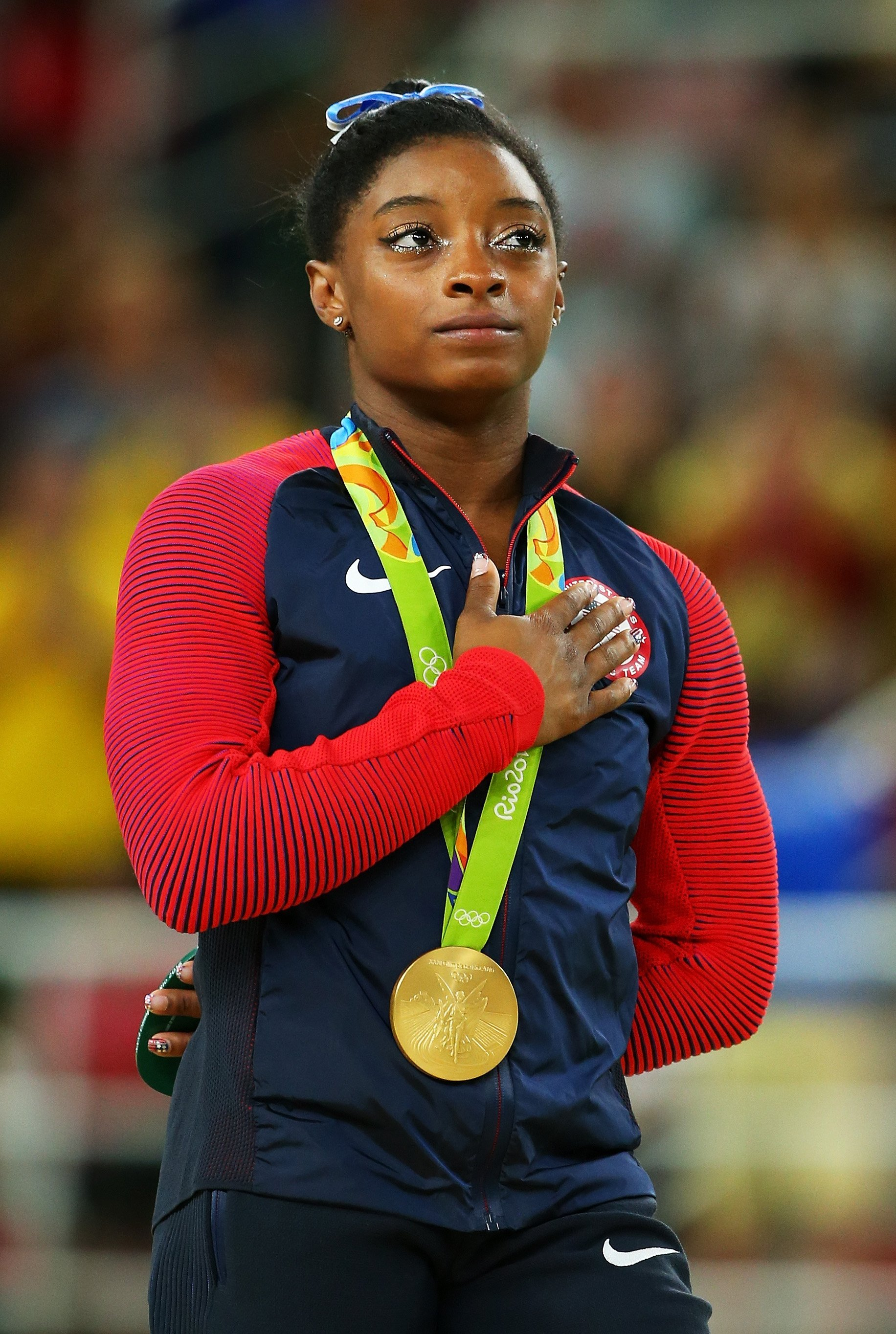 Simone Biles of the United States celebrates on the podium on Day 6 of the 2016 Rio Olympics. | Source: Getty Images