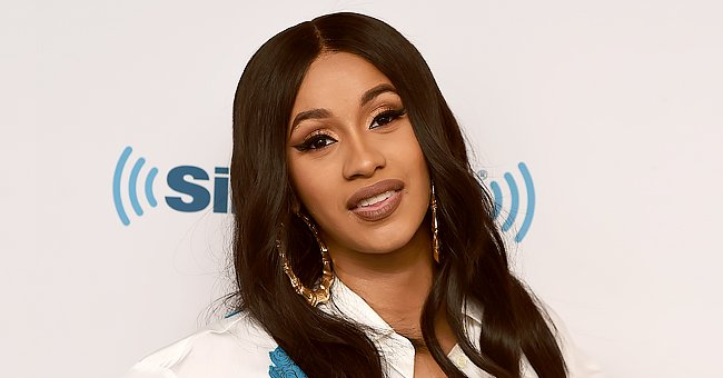 Cardi B Stuns in Neon Green Thigh-High Boots and Matching Sunglasses —She's a Hot Mama