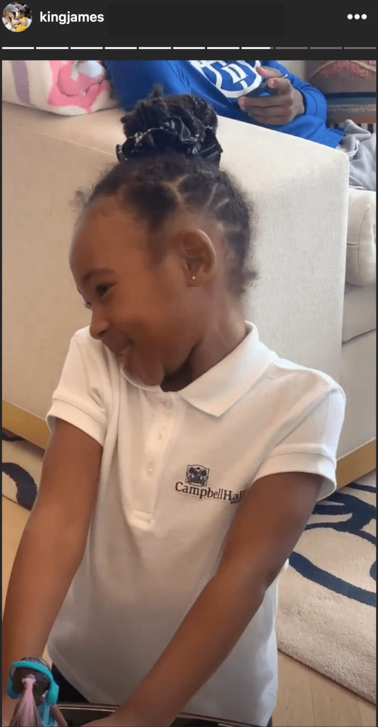 LeBron James' daughter Zhuri smiles as her dad sings her a birthday song. | Source: Instagram/kingjames
