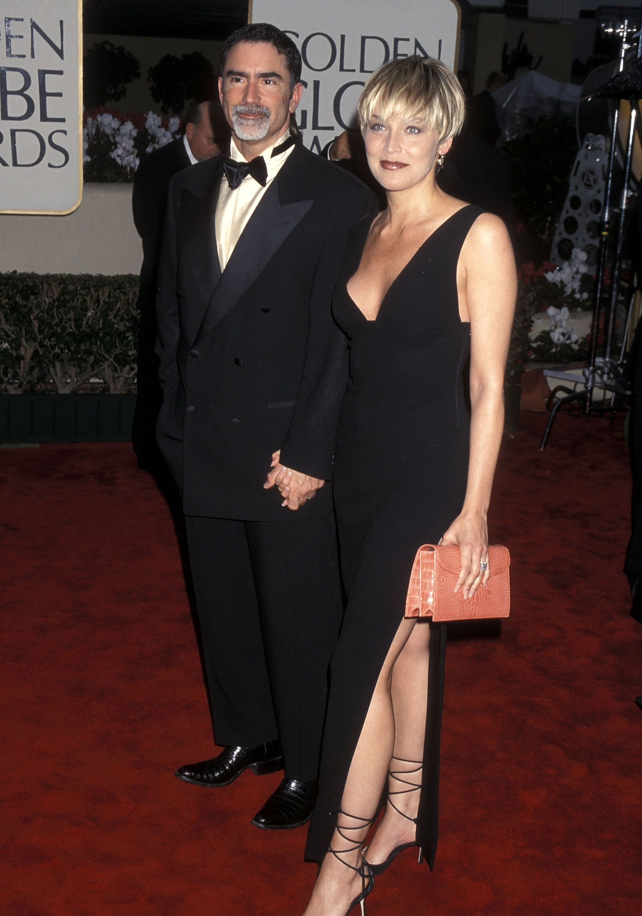 Sharon Stone and Phil Bronstein at the 57th Annual Golden Globe Awards in 2000 in Beverly Hills, California | Source: Getty Images