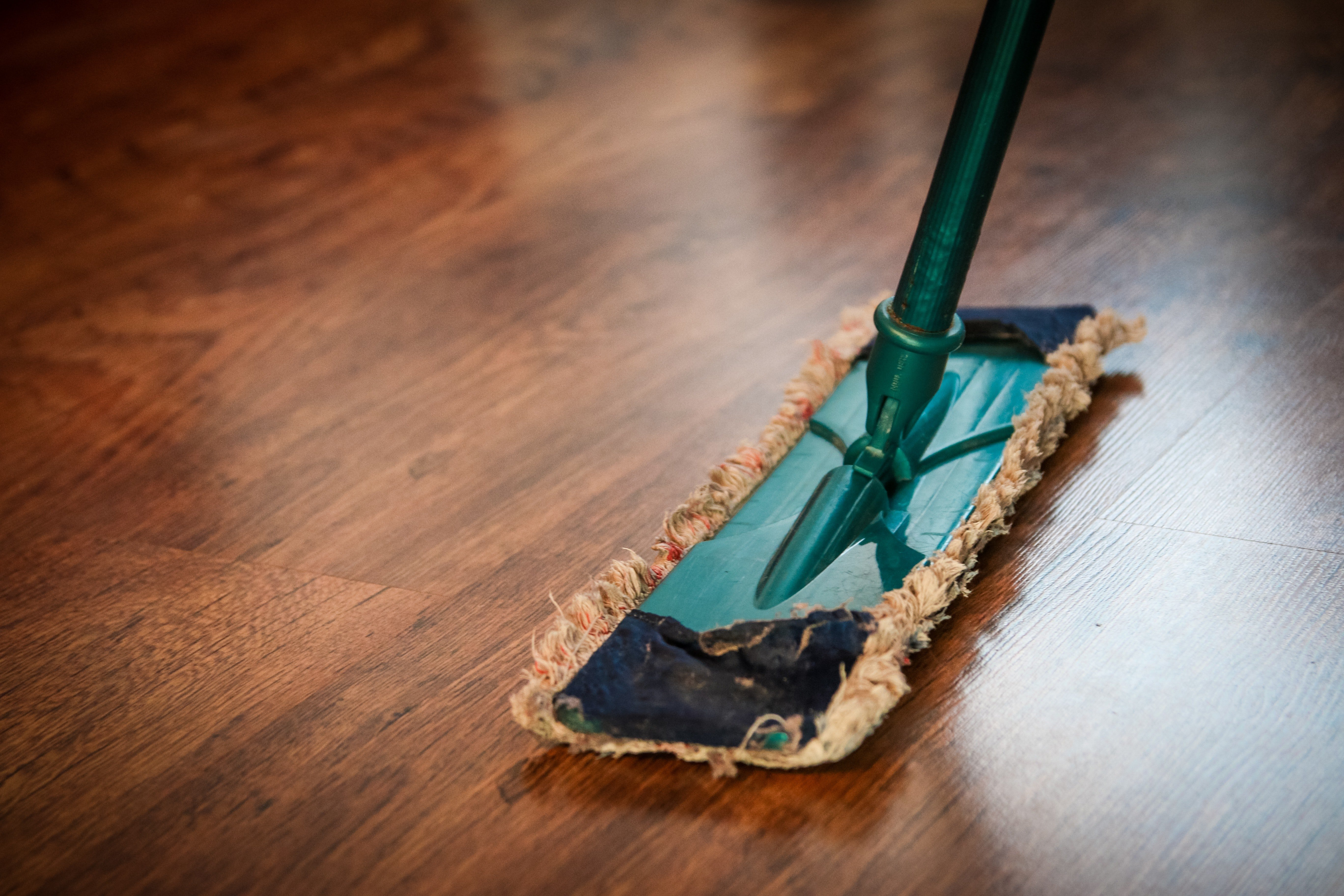 Mopping the floor. | Source: Pexels