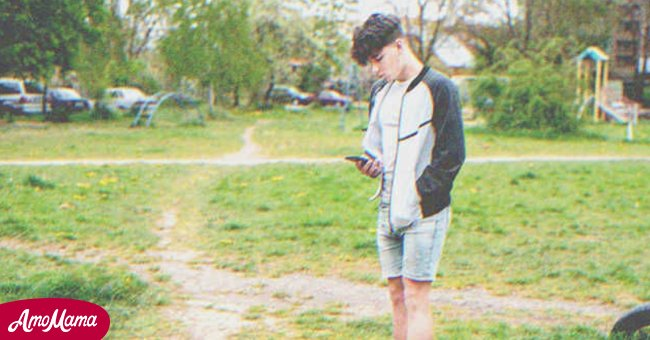 Teenager with a cellphone | Source: Shutterstock