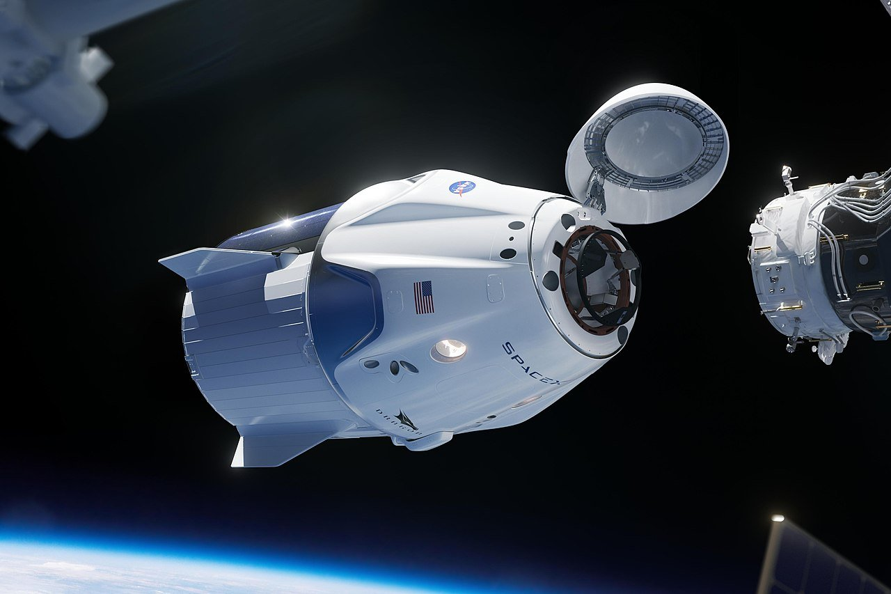 A rendering of a SpaceX Crew Dragon spacecraft approaching the International Space Station. Created on July 26, 2018 | Photo: Wikipedia/NASA/SpaceX