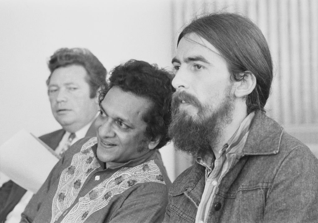 English musician George Harrison (1943-2001) of The Beatles posed on right with Indian musician Ravi Shankar (1920-2012) at a press reception at the Royal Festival Hall in London | Getty Images / Global Images Ukraine