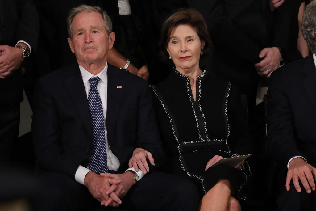 Former U.S. President George W. Bush and former first lady Laura Bush attend a memorial service for former President George H.W. Bush in the U.S. Capitol Rotunda | Photo: Getty Images