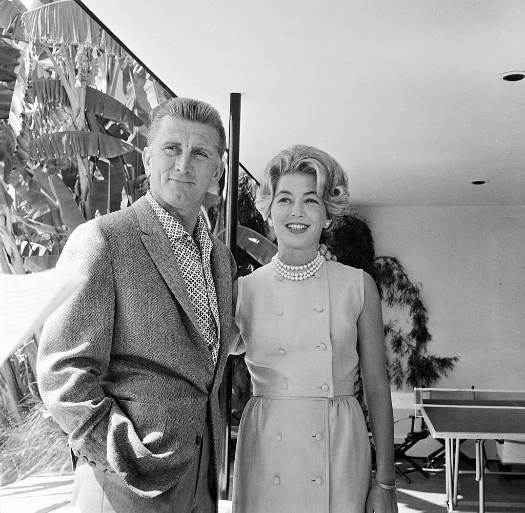 Kirk Douglas and his wife Anne stand on an episode of 'Person to Person' hosted by Edward R. Murrow, September 23, 1960. | Source: Getty Images.