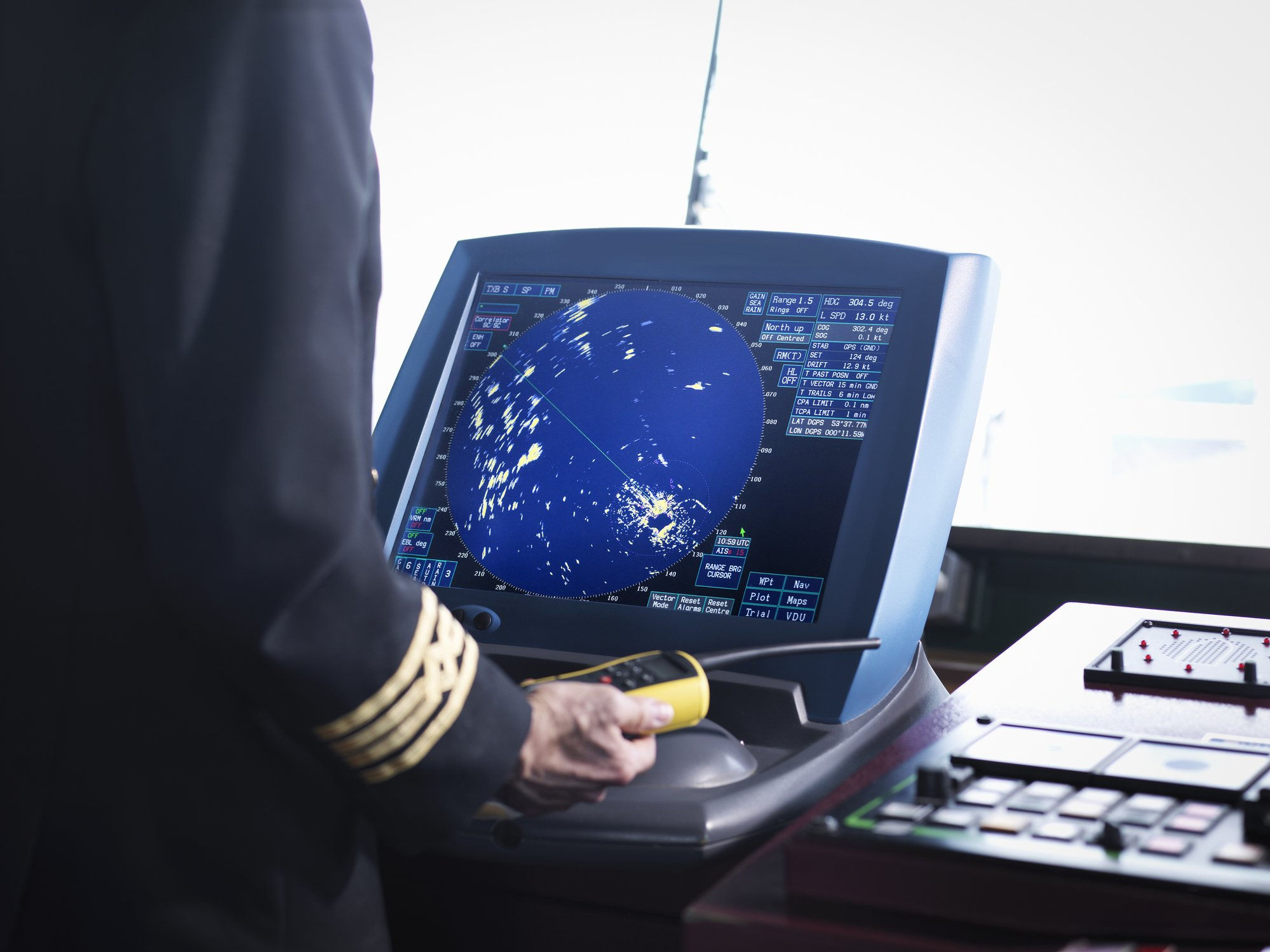 Ships captain working on bridge with radar screen, close up | Photo: Getty Images