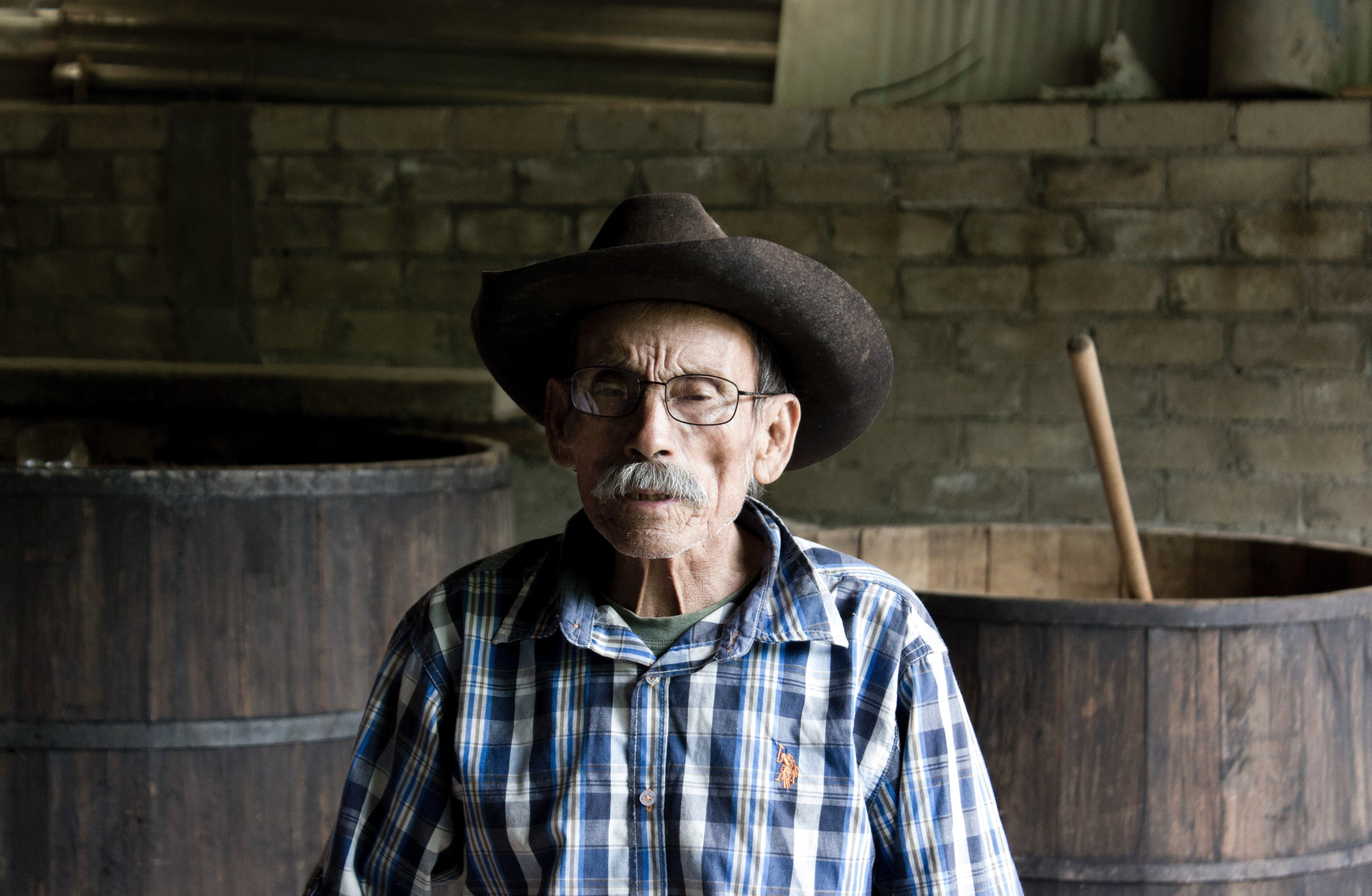 An old man with cowboy hat on.   Source: Pexels