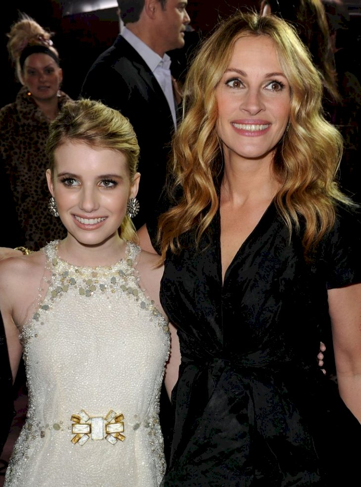 LOS ANGELES, CA - FEBRUARY 08: Actresses Emma Roberts (L) and Julia Roberts arrive at the premiere of New Line Cinema's