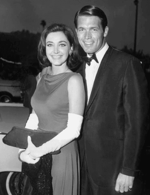 Shelby Grant and Chad Everett pose in formal attire at the west coast premiere of director Vincente Minnelli's film, 'The Sandpiper,' Hollywood Paramount Theatre, Hollywood, California. The screening was a benefit for the Hemophilia Foundation of Southern California. (Photo by Hulton Archive/Getty Images)
