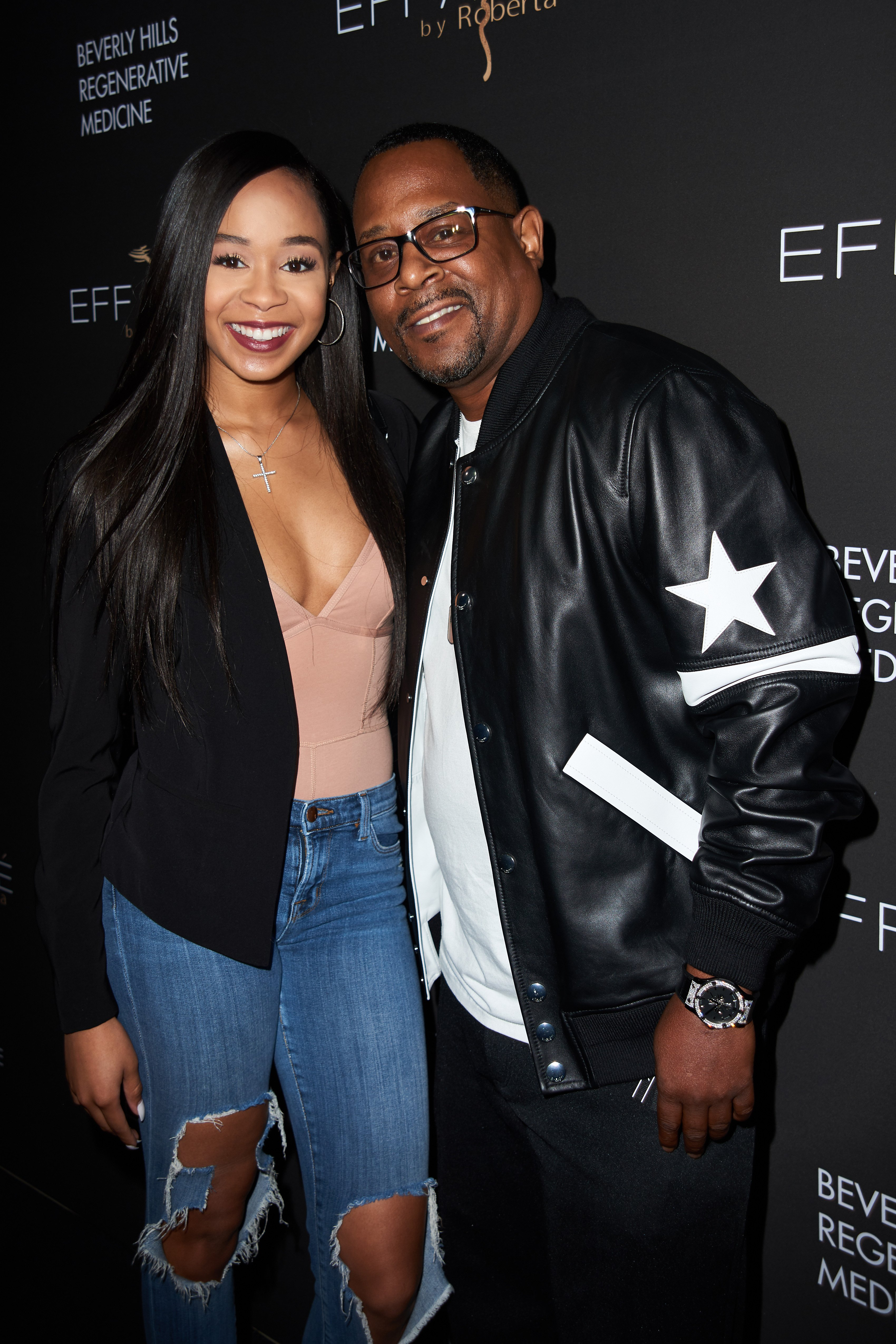 Martin Lawrence and Jasmin Lawrence pose at the grand opening of Roberta Moradfar's Efface Aesthetics on December 12, 2019 in Santa Monica, California.   Source: Getty Images