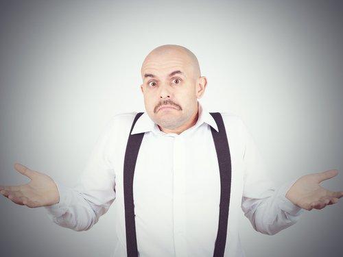 A man shrugging. | Source: Shutterstock.