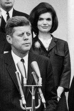 President John F. Kennedy speaks during a press conference at the White House as First Lady Jackie Kennedy looks on April 9, 1963   Source: Getty Images