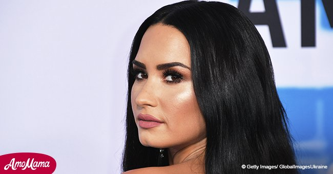 Demi Lovato leaves nothing to imagination as she poses in black low cut swimsuit