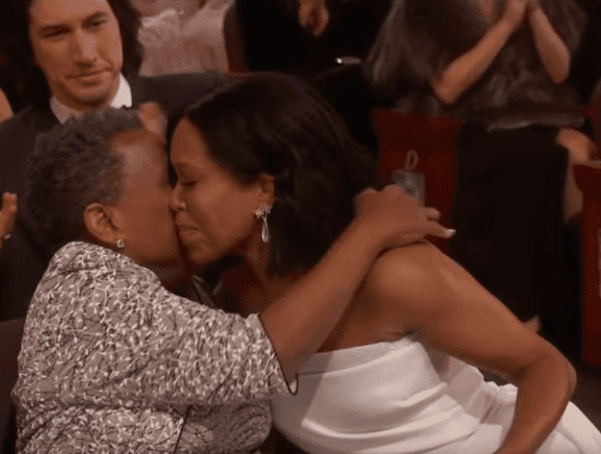 """Screenshot of Regina King hugging her mother after she is announced as the winner of the """"Actress In a Supporting Role"""" category at the 2019 Academy Awards. 