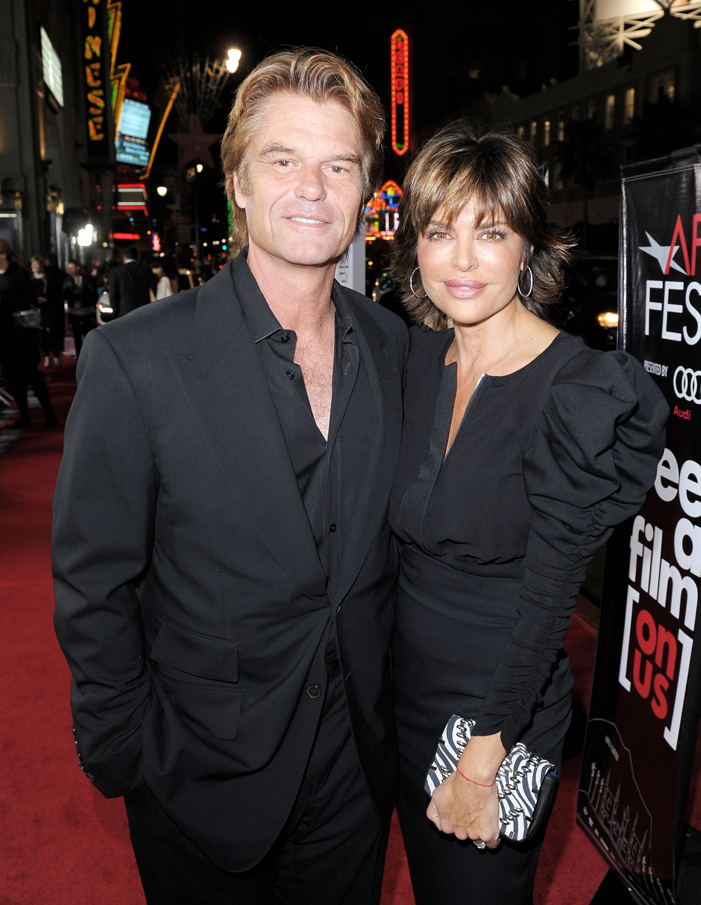 "Harry Hamlin (L) and wife Lisa Rinna arrive at the AFI FEST 2009 screening of the Weinstein Company's ""A Single Man"" on November 5, 2009, in Los Angeles, California. 