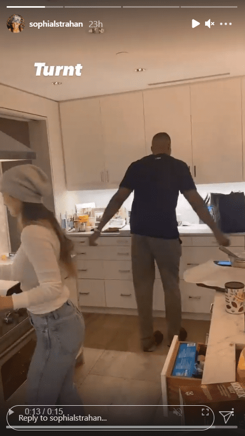 A screenshot of Michael Strahan and his girlfriend Kayla Quick having a fun time in the kitchen cooking. | Photo: Instagram/Sophianlstrahan