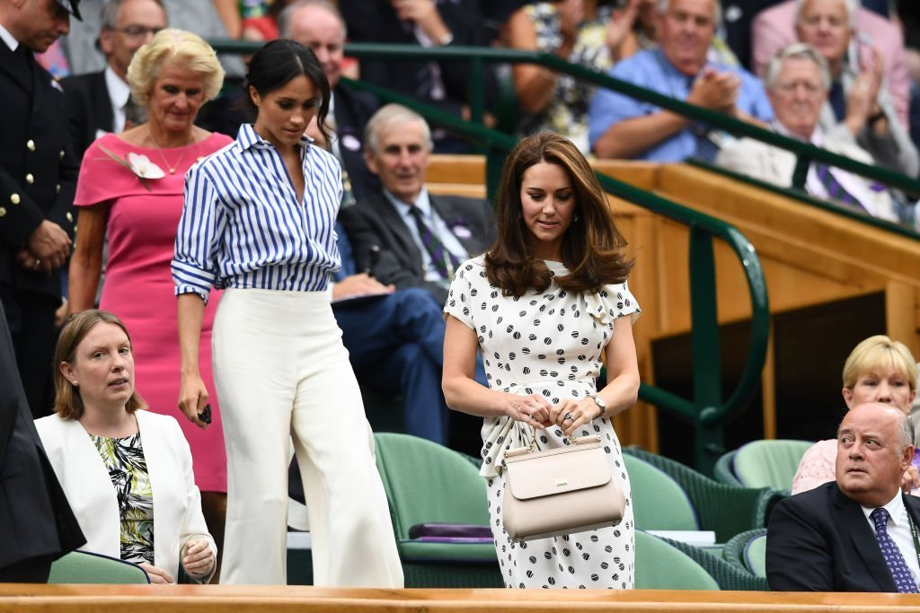 Kate Middleton and Meghan Markle attend day twelve of the Wimbledon Lawn Tennis Championships at All England Lawn Tennis and Croquet Club on July 14, 2018 | Photo: Getty Images