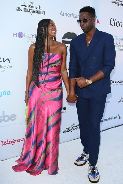 Gabrielle Union and husband, Dwyane Wade having a good time on the red carpet at the HollyRod Foundation's 21st Annual DesignCare Gala | Photo: Getty Images