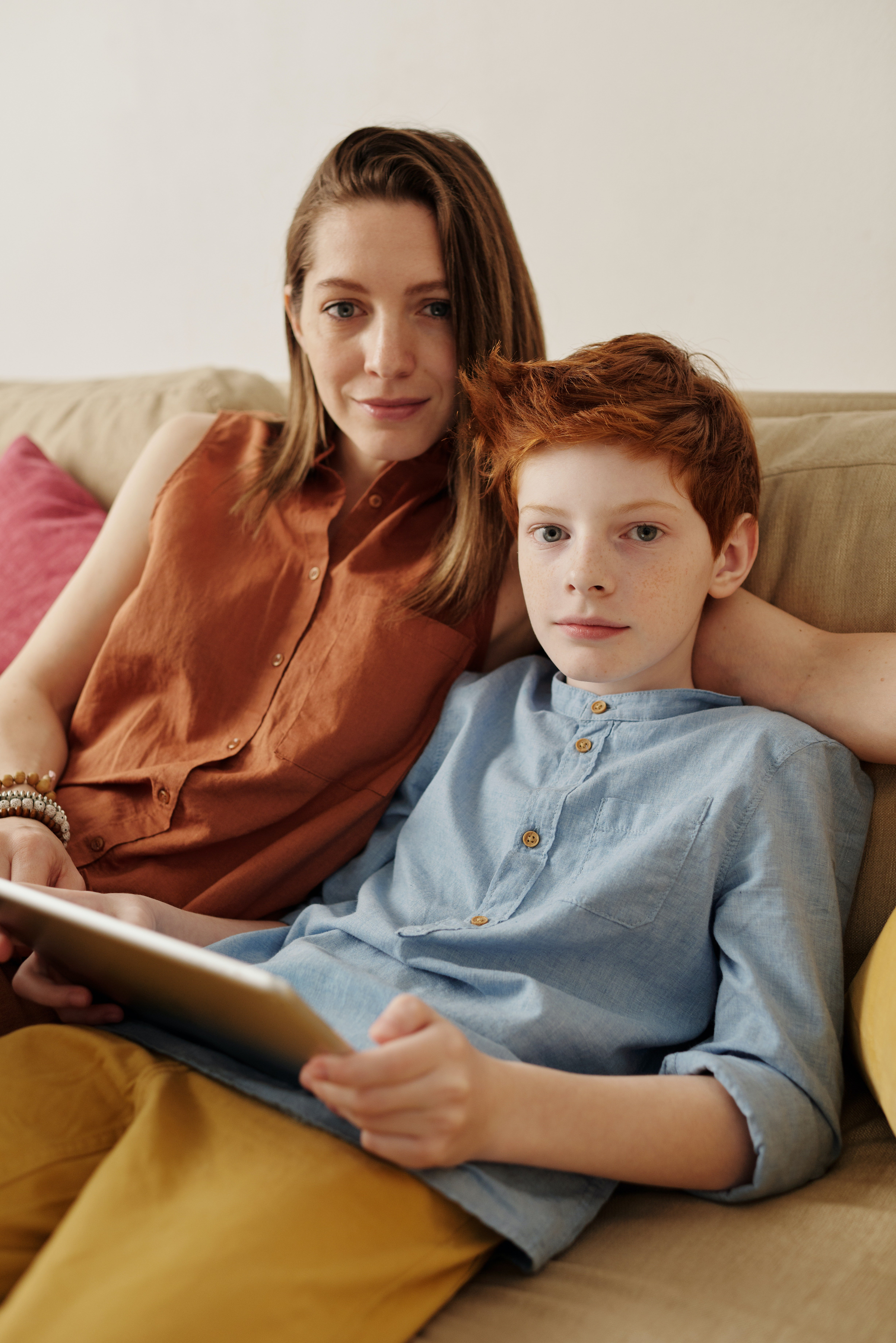 Mother and son sitting on a sofa   Photo: Pexels