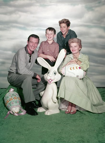 """Hugh Beaumont, Jerry Mathers, Tony Dow, and Barbara Billingsley, posed for a publicity photo of """"Leave It to Beaver"""" in an Easter setting, circa 1957.   Photo: Getty Images"""