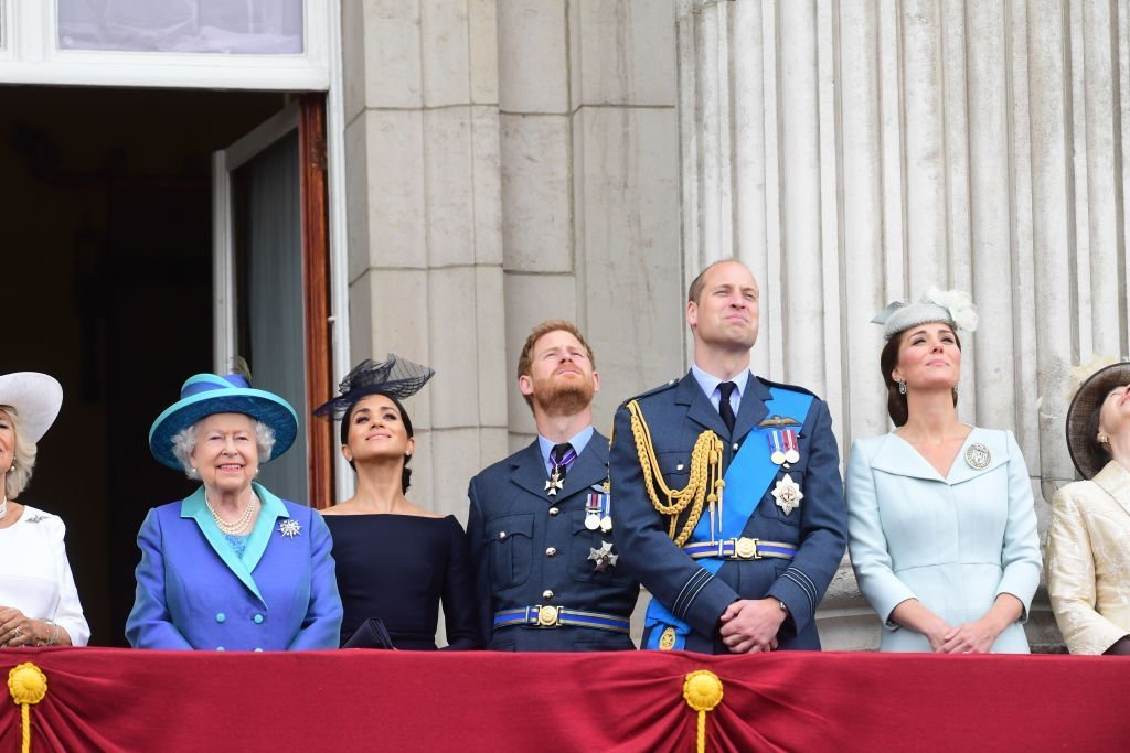 Queen Elizabeth II, Meghan Markle, Prince Harry, Prince William, Catherine, Duchess of Cambridge and Princess Anne, watch the RAF 100th anniversary flypast from the balcony of Buckingham Palace on July 10, 2018 | Photo: GettyImages