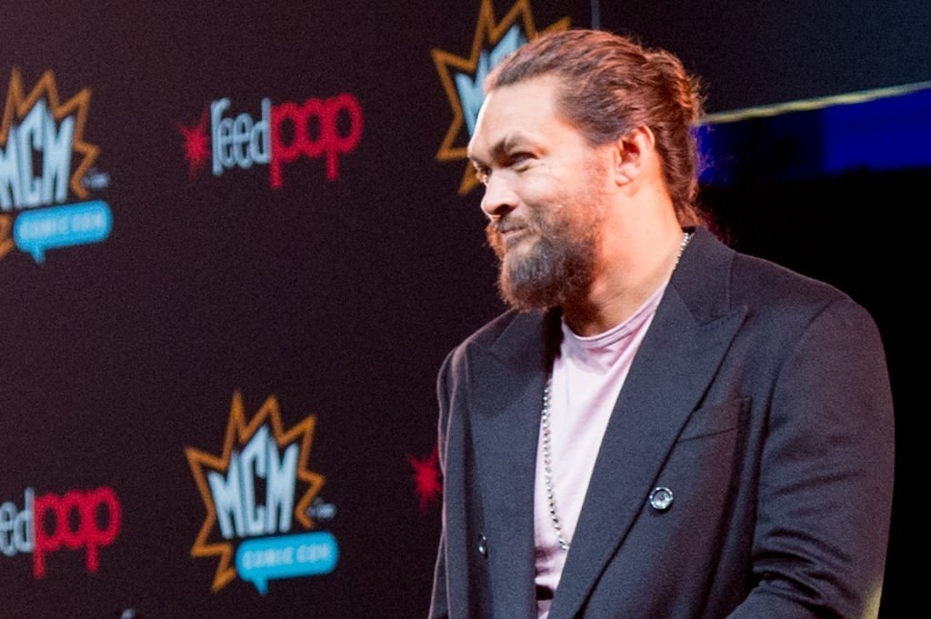 Jason Momoa smiles during a panel at the world premier of 'See' during day 1 of the October MCM London Comic Con 2019 at ExCel | Photo: Getty Images