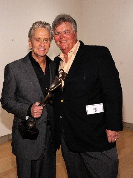Michael Douglas (L) and producer Joel Douglas attend the Icon Award Presentation during the 22nd Annual Palm Springs International Film Festival at the Annenberg Theatre on January 13, 2011, in Palm Springs, California. | Source: Getty Images.