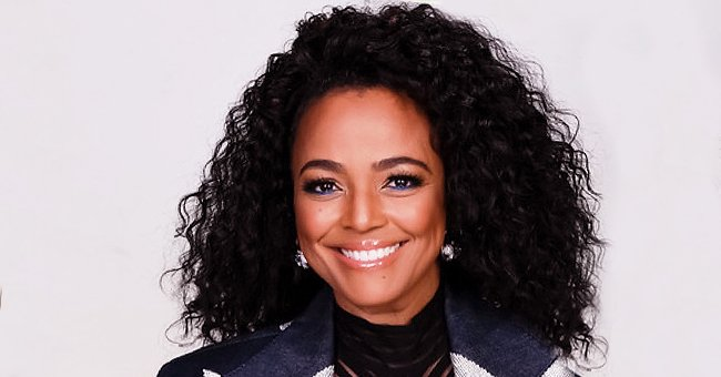 Kim Fields from 'Living Single' Is Gorgeous with Curly Hair and Sheer Striped Top Paired with a Blue Jacket