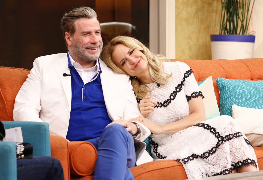 """John Travolta and Kelly Preston are seen on the set of """"Despierta America"""" at Univision Studios on June 8, 2018, in Miami, Florida. 