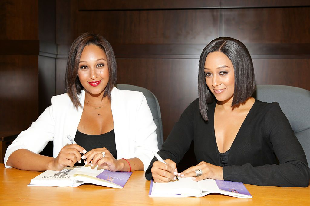 "Tamera Mowry and Tia Mowry at their book signing for ""Twintuition"" on April 21, 2015 in Los Angeles, California. 