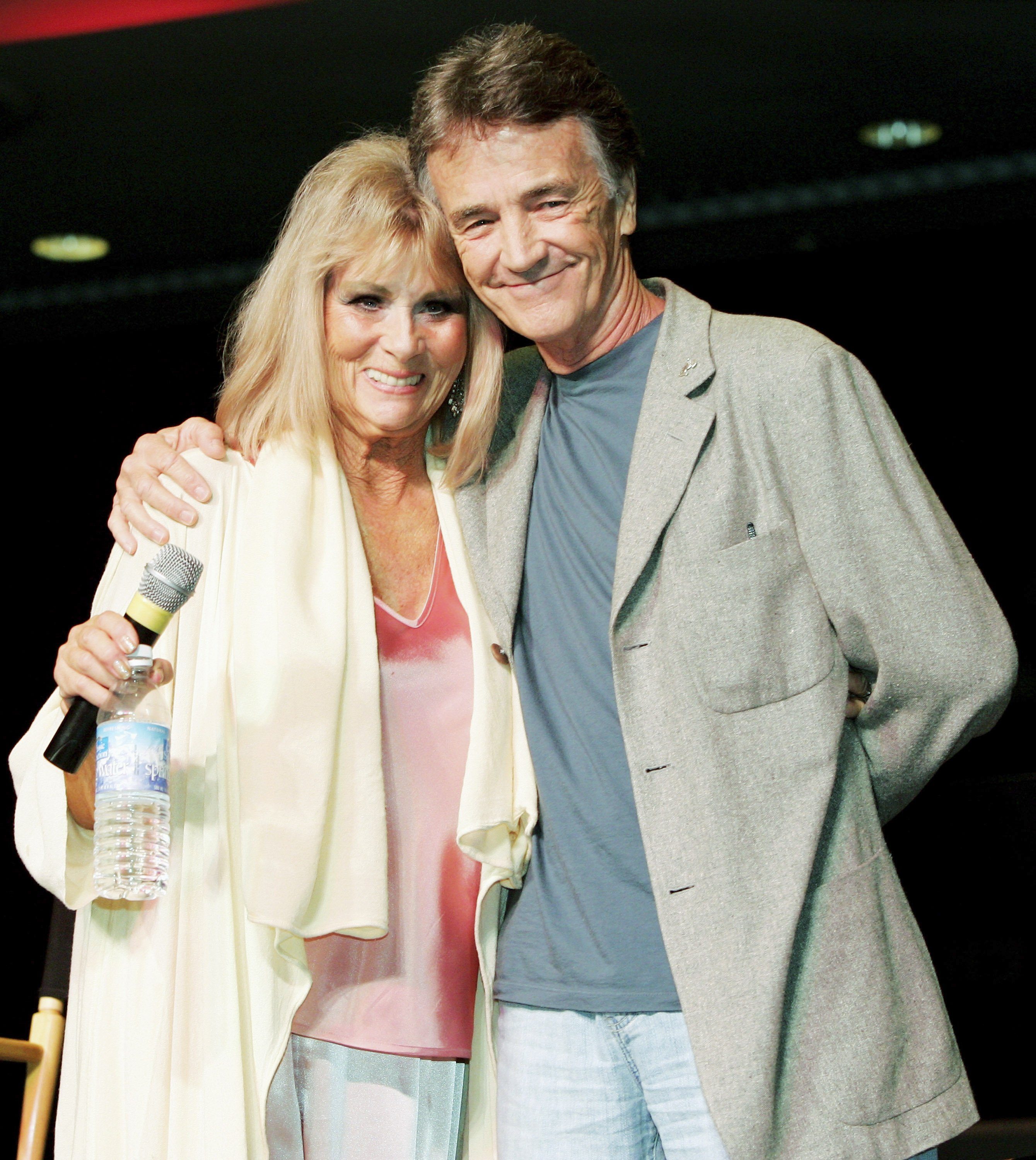 """Grace Lee Whitney, who played Janice Rand in the original """"Star Trek"""" television series and films, and actor Robert Walker Jr, who played the character Charlie Evans pose at the Star Trek convention at the Las Vegas Hilton August 11, 2005, in Las Vegas, Nevada 