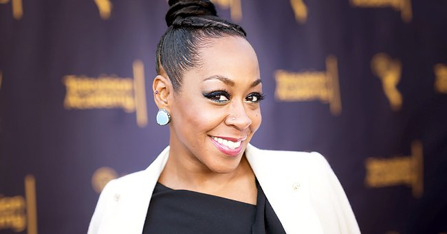Tichina Arnold Turns Heads Strutting in a Snake-Print Face Mask With a Fendi Top & Tight Pants