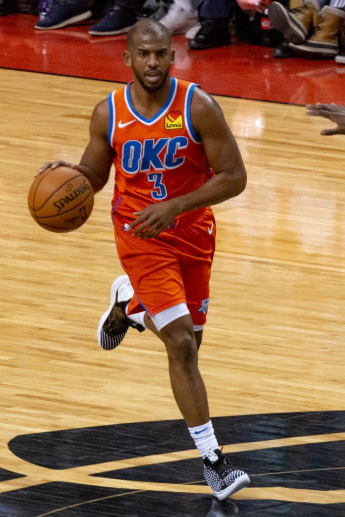Oklahoma City Thunder player, Chris Paul, runs with the basketball during a game with the Toronto Raptors on December 29, 2019, in Toronto, Canada | Source: Anatoliy Cherkasov/NurPhoto via Getty Images