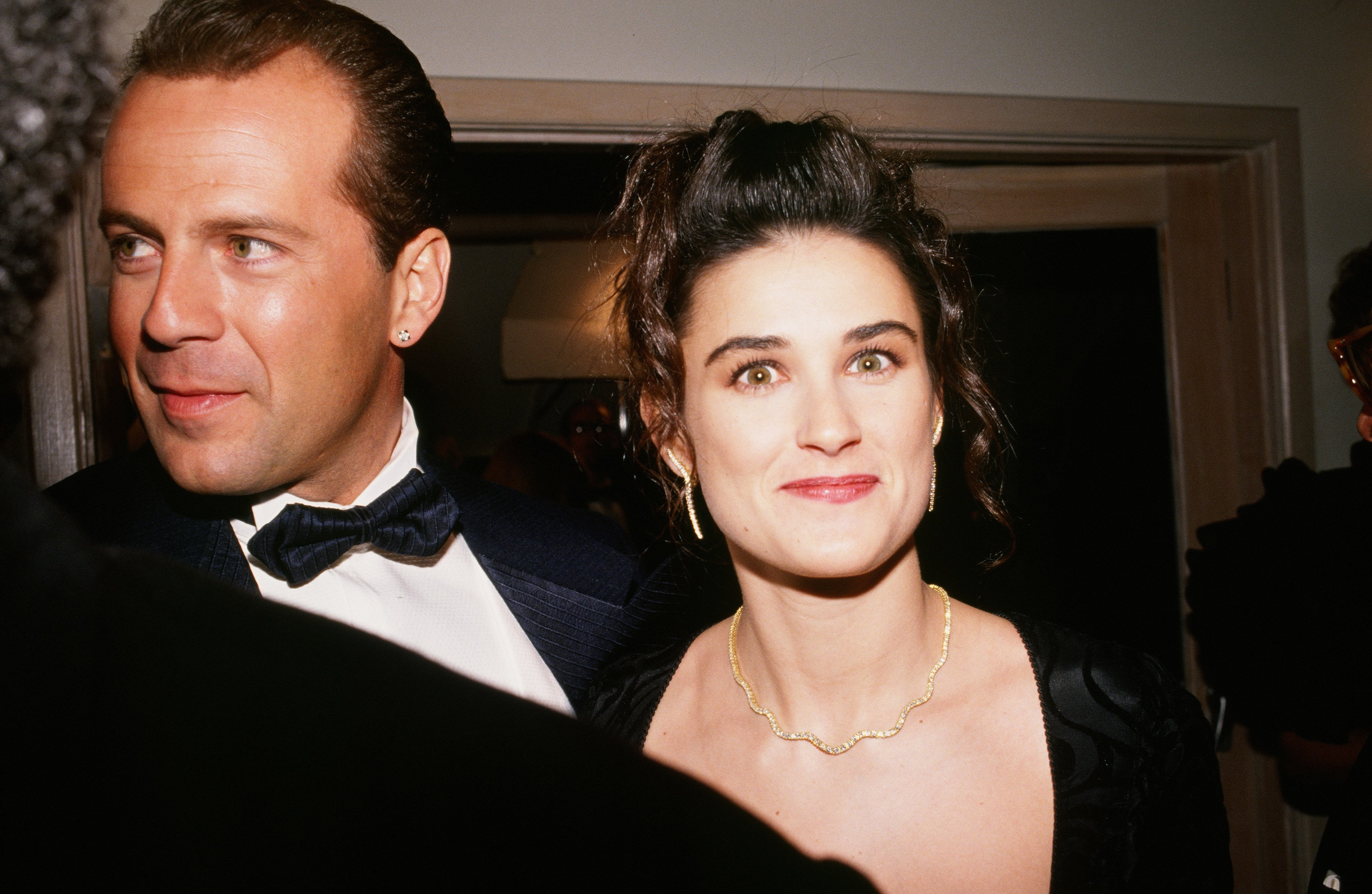 """Bruce Willis and Demi Moore arrive at the 1989 West Hollywood, California, Irving """"Swifty"""" Lazar Oscar Party held at Spago. 