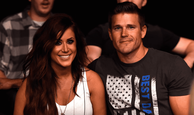 Chelsea Houska and her husband Cole DeBoer watch the fights during the UFC Fight Night event on July 13, 2016 at Denny Sanford Premier Center in Sioux Falls, South Dakota. | Photo: YouTube/US Weekly