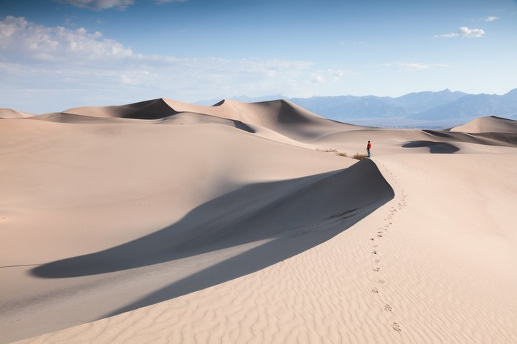 Tourist at Mesquite Sand Dunes, Death valley, USA | Photo: Getty Images