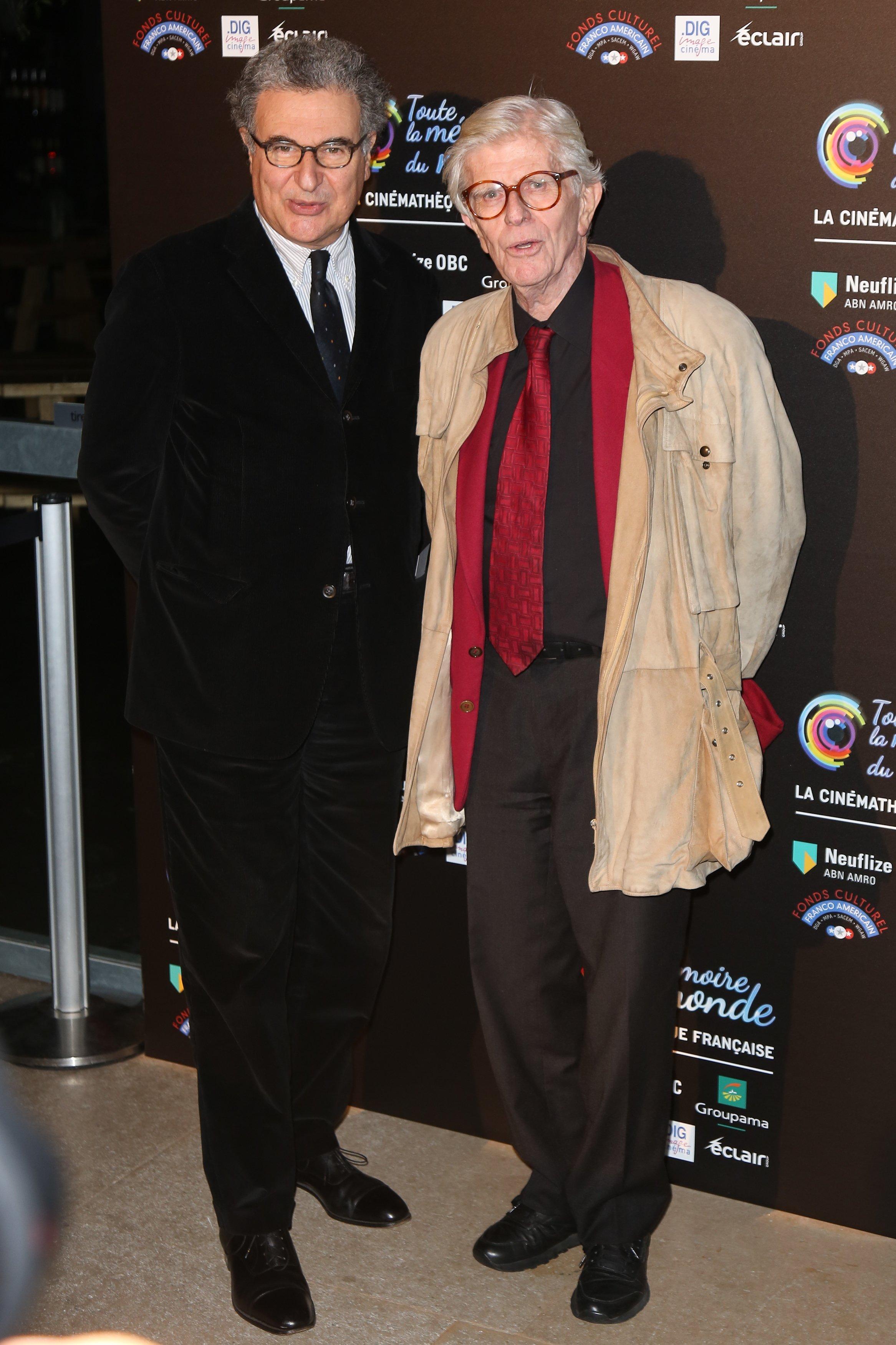 Francaise Serge Toubiana et Henry Chapier lors du 'Festival International du Film Restaure' à la Cinémathèque Française à Paris, France | Photo : Getty Images
