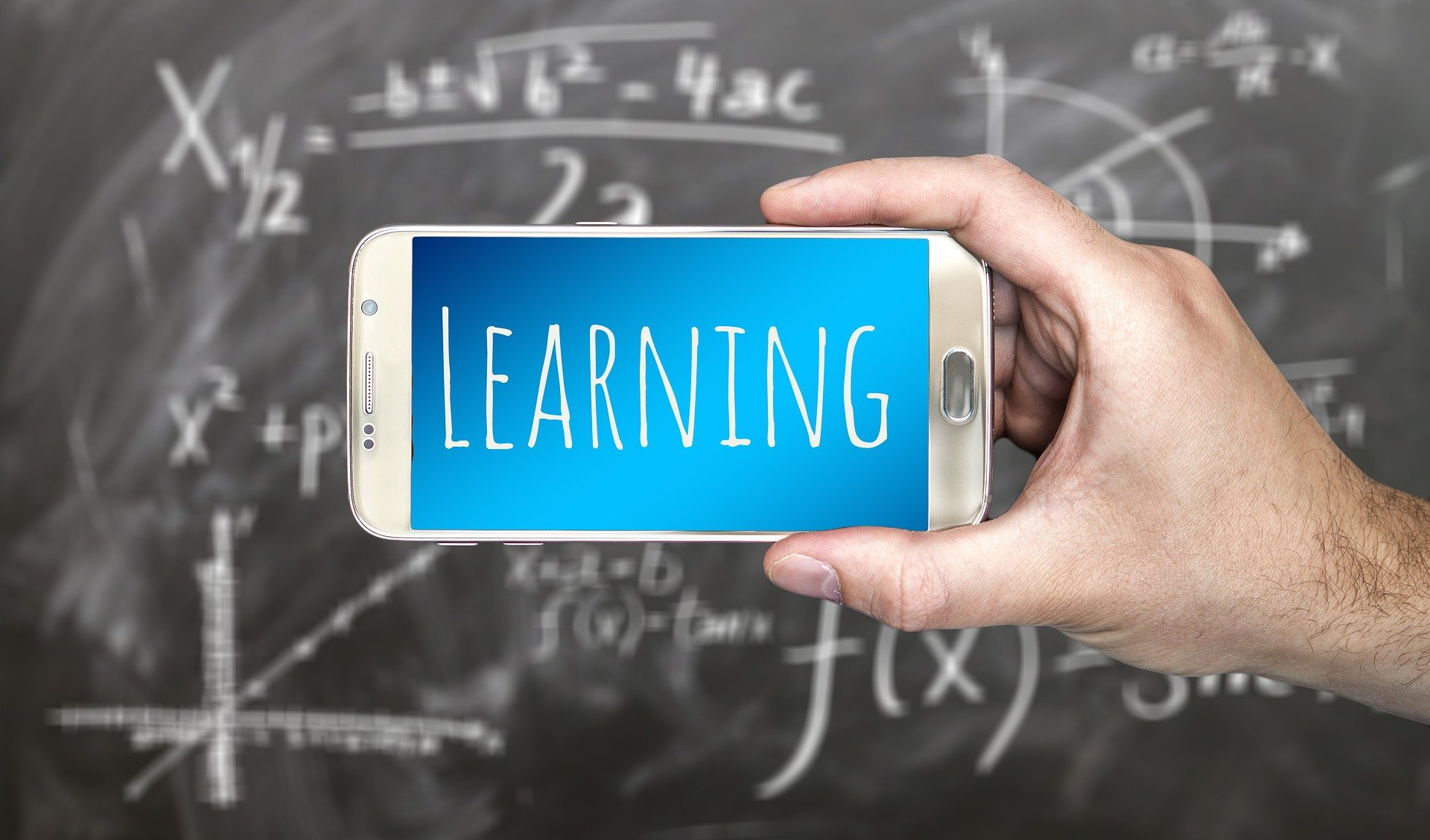 Pictured - A smartphone and mathematics formiulas on the board   Source: Pixabay