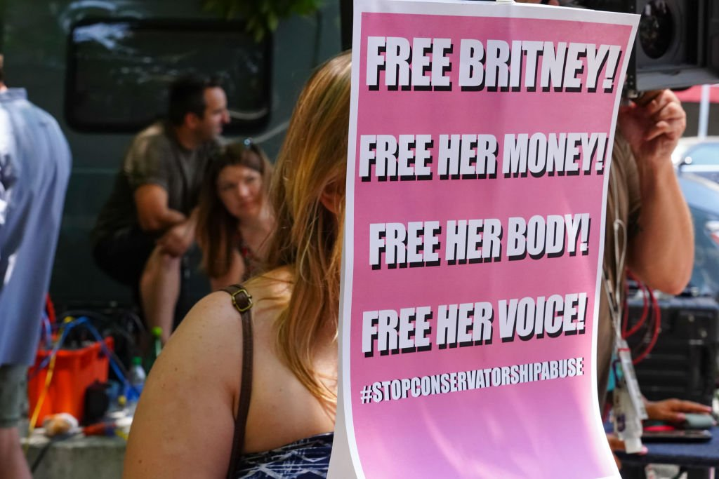 A fan holding up their poster during a 'Free Britney' Rally, July 2021 | Source: Getty Images