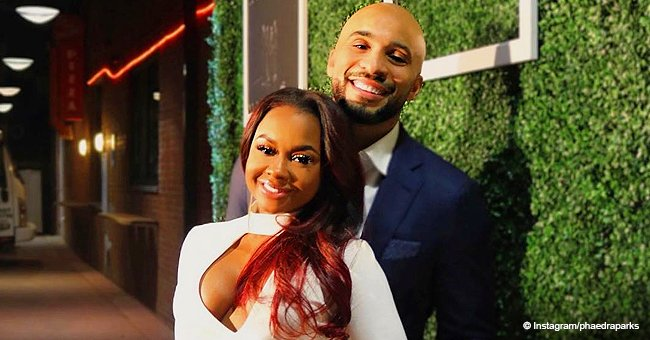 Phaedra Parks stuns in figure-hugging white dress while posing with new boyfriend Tone Kapone