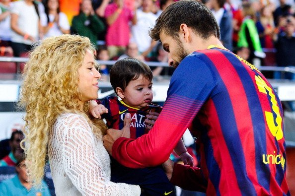 Shakira and Gerard Pique of FC Barcelona are seen with their son Milan prior to the La Liga match between FC Barcelona and Sevilla FC at Camp Nou on September 14, 2013, in Barcelona, Spain. | Source: Getty Images.