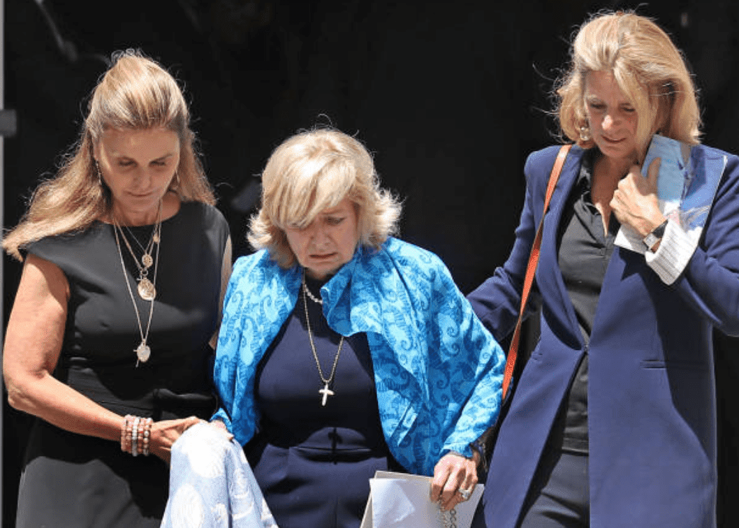 Courtney Kennedy Hill consoled by Maria Shriver and Sydney Lawford McKelvy after the funeral services for the granddaughter of Robert F. Kennedy, Saoirse Roisin Kennedy Hill, at Our Lady of Victory Church, on Aug. 5, 2019, Boston | Source: David L. Ryan/The Boston Globe via Getty Images