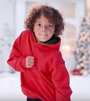 "Mariah Carey's son Morocco in the new video ""All I Want For Christmas Is You""/ Source: YouTube/ Mariah Carey"
