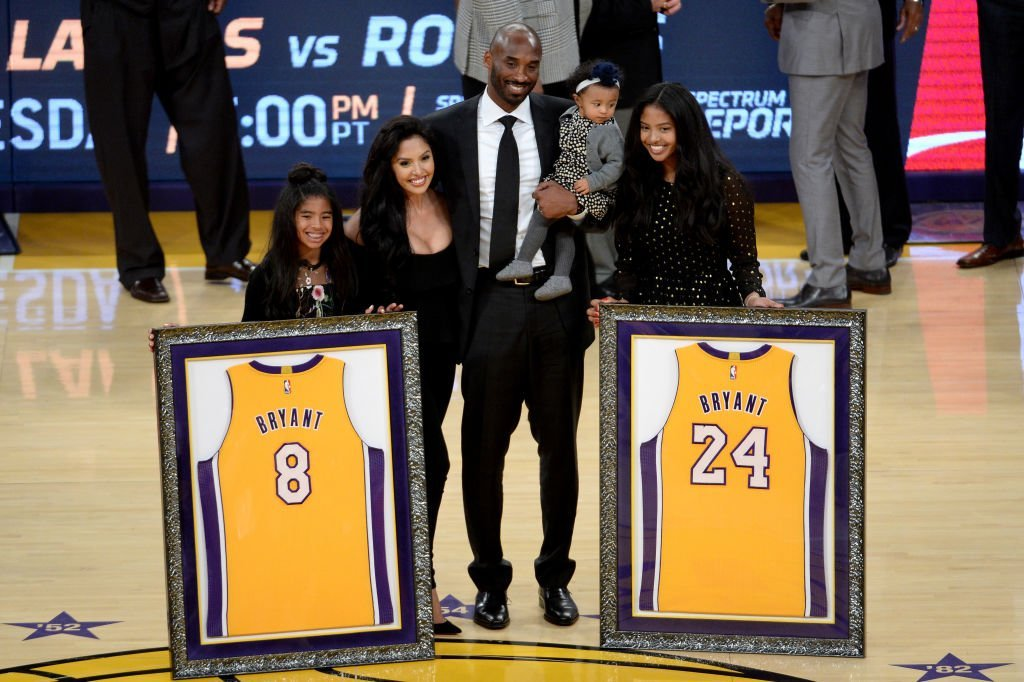 Kobe Bryant poses with his family, Vanessa, Gianna, Natalia, and Bianka at halftime after both his Los Angeles Lakers jerseys are retired at Staples Center, on December 18, 2017, in Los Angeles, California | Source: Maxx Wolfson/Getty Images