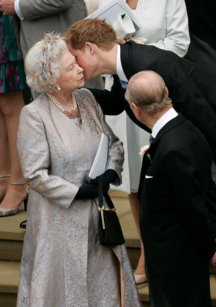 Prince Harry kisses Queen Elizabeth II after Peter Phillips's wedding to Autumn Kelly in Windsor Castle on May 17, 2008, in England | Photo: POOL/Tim Graham Picture Library/Getty Images