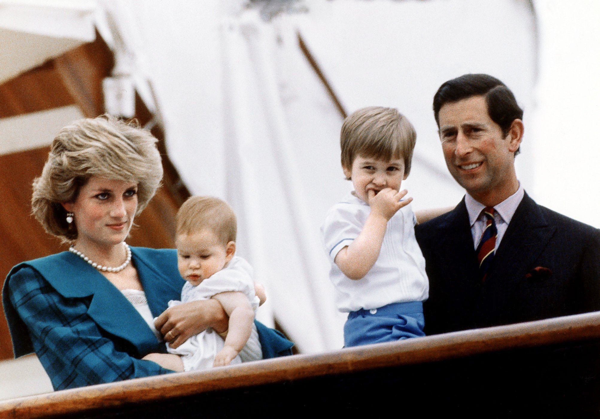 Princess Diana and Prince Charles pose with their sons Princes Harry and William on board royal yacht Britannia during their visit to Venice, Italy, 6th May 1985   Photo:  Getty Images